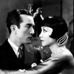In this picture, playing against Anna May Wong, is Sessue Hayakawa, a Japanese actor who was surprisingly popular in the US, rivalling white actors, during the silent film era.