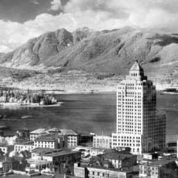 Vancouver in 1931. The Lion's Gate Bridge, connecting the city to the northern shorts, wasn't built until 1937. In this story, its equivalent, the 'Komainu Bashi,' is built earlier because Vancouver is a slightly more populous metropolis.