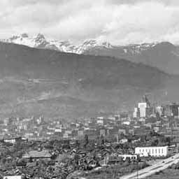 Vancouver in 1933. As you get away from the city core, there is undeveloped land. This picture was taken from a park called 'Little Mountain,' now called 'Queen Elizabeth Park,' looking north toward the city.