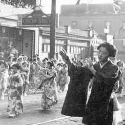 Although it was gutted by the internment policies during World War 2, Vancouver had a small but thriving Japanese community from the end of the 1800s through to the 1930s. This image is from a Japanese festival on or near Powell Street, which was part of 'Japantown.' (Note the cultural mixing on the sign with an image of Mount Fuji, offering 'Chop Suey')