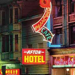Vancouver had a lot of neon in the thirties and through the sixties and after. This picture was taken in the seventies or so, but you can still see the wood buildings likely built much earlier in the century. This is close to what the world of this story would look like.